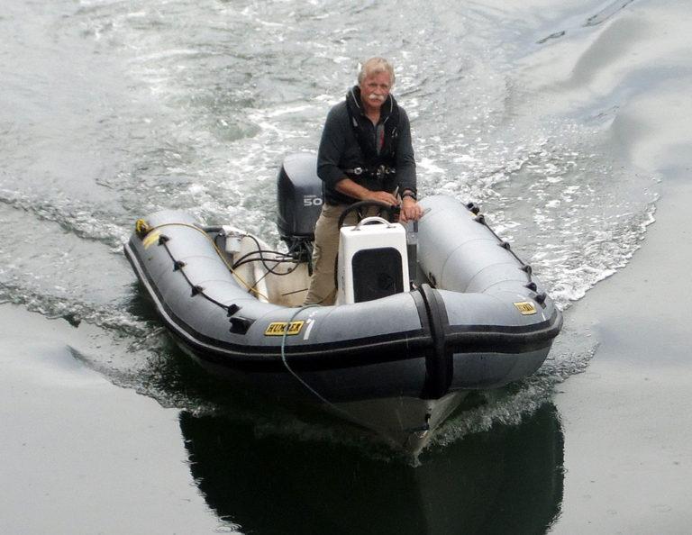 man on dinghy